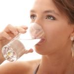 Woman drinking Tropic Water